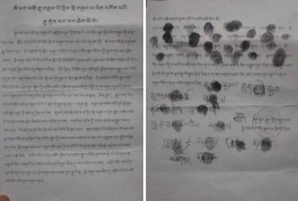 Kopie der mit Fingerabrücken unterzeichneten Petition (Foto: Radio Free Asia)