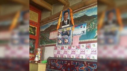 Geldprämien für das Aufhängen von Xi Jinping Portraits